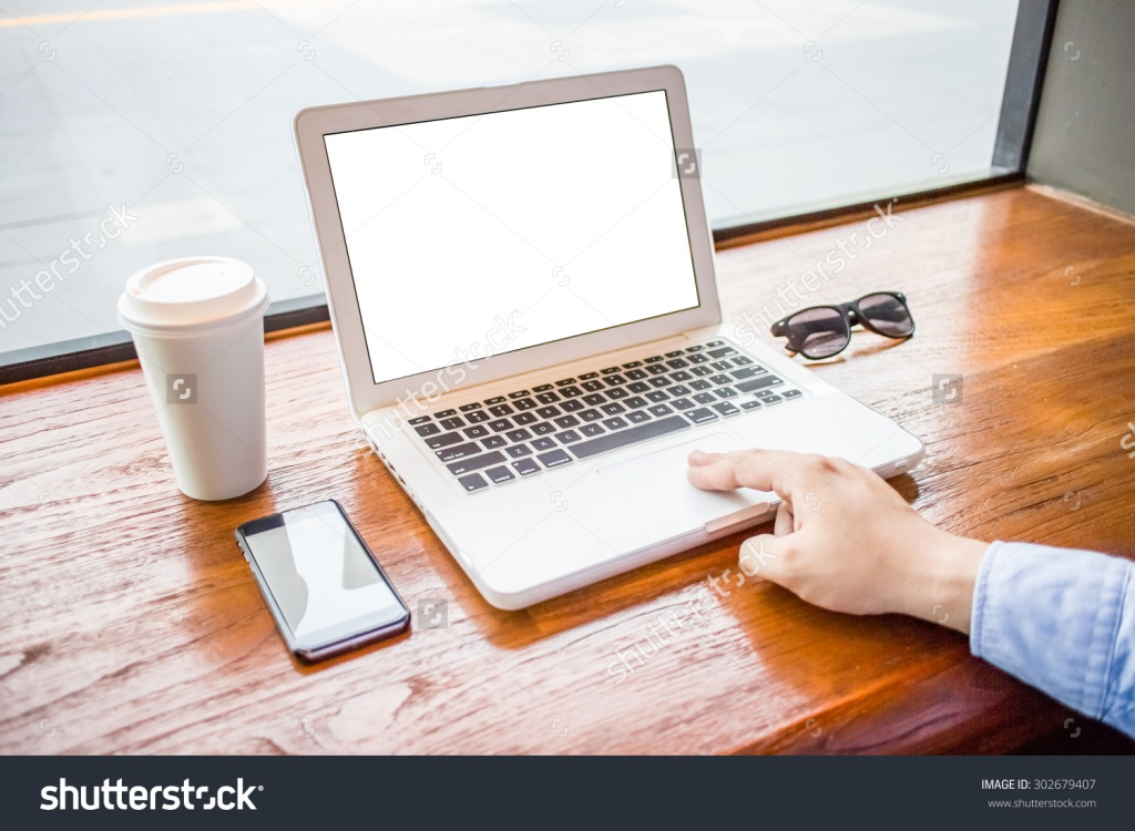 stock-photo-man-using-a-laptop-during-a-coffee-break-hands-close-up-302679407